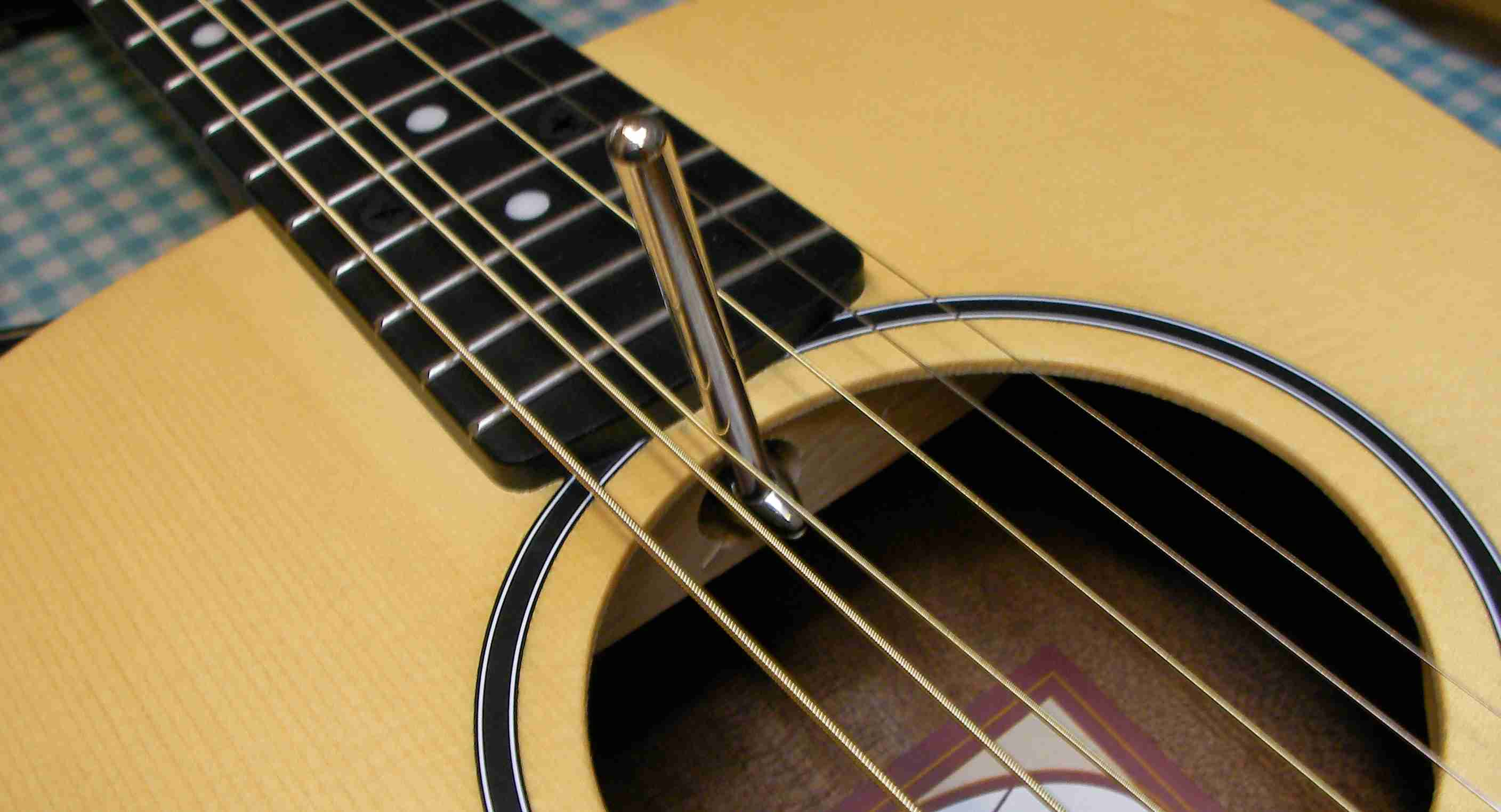 how to set guitar strings height