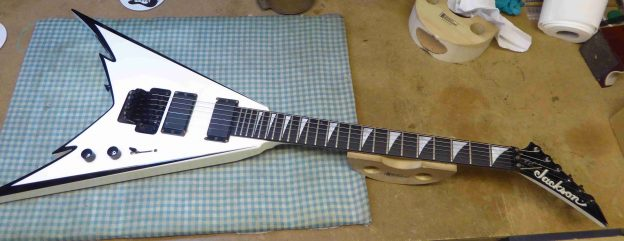 Jackson guitar on the bench before any work was carried out