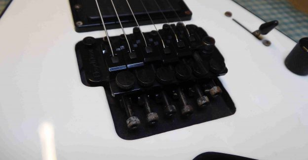 Closeup view of a Floyd Rose Tremolo fitted to a Jackson guitar