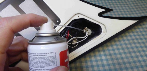 Cleaning a set of Jackson Guitar volume and tone controls with switch cleaner