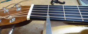 Measuring the action height at the first fret on a Martin acoustic guitar
