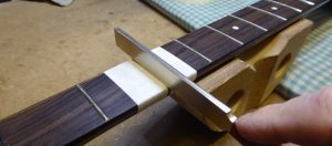 Re-crowning the top of a dressed fret