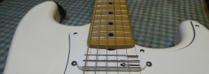 Looking along a wonky neck of a fender stratocaster