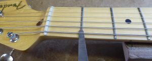 Measuring the action height at the first fret on a fender stratocaster