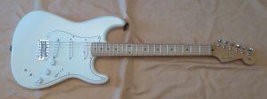A white U S made Fender Stratocaster