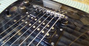 Schecter 7 string with new bridge fitted by Guitar-George